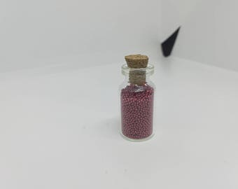 1 vial in a mini glass bottle with Cork