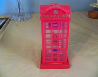 red plastic seventies telephone booth bank novelty item