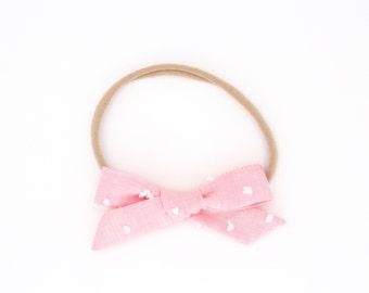 "Fabric ""Olivia"" girl bow // nylon headband or alligator clip//  baby girl/ toddler/ big girl - Pink swiss dot"