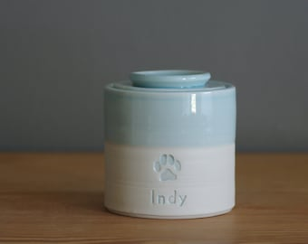 Pet urn. Customized small urn for human or pet cremains and ashes. modern pottery urn. lidded urn. ice blue, porcelain, paw print