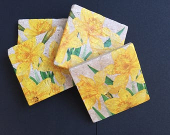 Set of four [4] handmade naturel Travertine stone drinks coasters in a yellow daffodil design