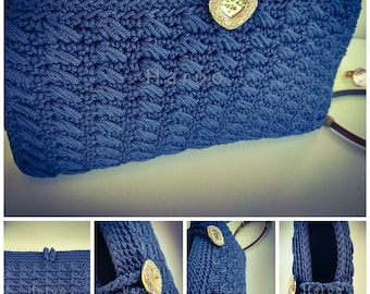 Blue wallet bag with golden clasp.