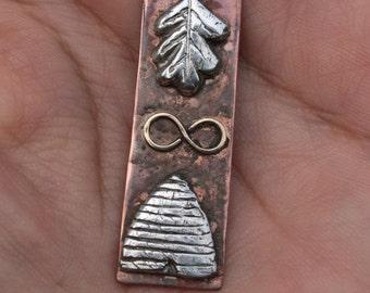 Beehive,oak leaf pendant. Silver on Coppe