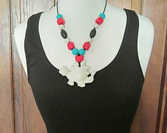 Off white dinosaur children's necklace Southwest inspired * dinosaur sensory necklace * dinosaur Baby Carrier accessory * tula, lillebaby