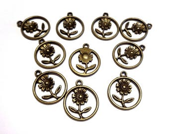 4 charms in antiqued bronze circle, diameter 15 mm Daisy flower