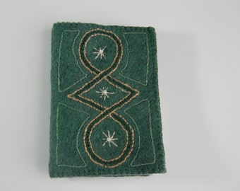 green embroidered needle book