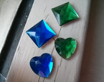 Handmade set of four upcycled plastic jewels into magnets