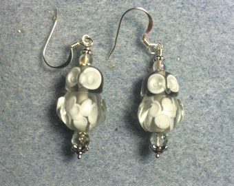 Grey lampwork owl bead dangle earrings adorned with grey Czech glass beads.