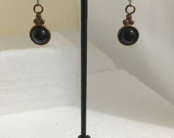 Brass circle lever back earrings with black onyx stones