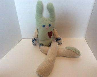 Soft pastel green repurposed sweater stuffed bunny