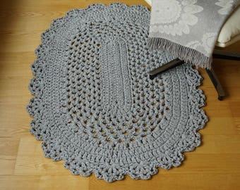 Crocheted light grey oval rug