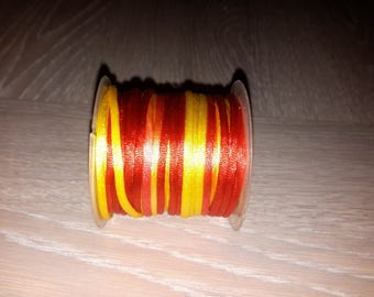 roll of 5 meters of cord which is bicolour red and yellow