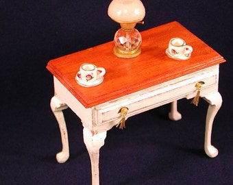 Queen Anne style occasional table, opening drawer, gold tassels on escutcheons. 12 inch dollhouse scale. Hand made in USA.