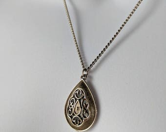 Celtic Style Silver Teardrop Pendant Necklace on a silver curb chain