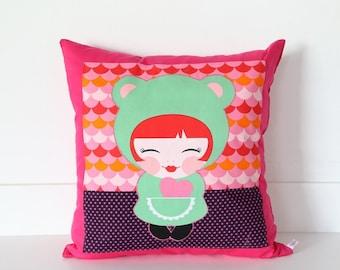 Square cushion Kokeshi doll for children's room.