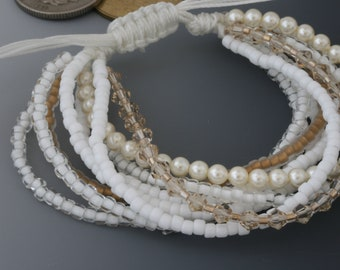 Multistrand bracelet with macrame sliding knot. One size fits most. White and cream and gold jewelry.
