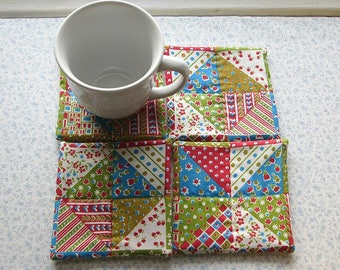 vintage fabric blue green and red hand quilted set of mug rugs coasters