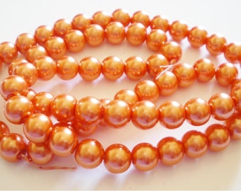 Mother of Pearl 12 mm orange glass beads