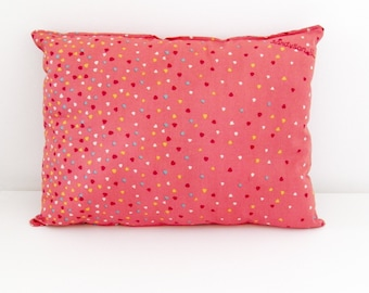 Cushion in pink cotton fabric with hearts
