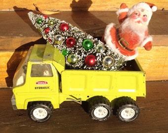 Christmas chartruese lime green Tonka dump, decorated Christmas tree, Santa Claus. Mantle decor. Holiday decoration. Christmas decor.