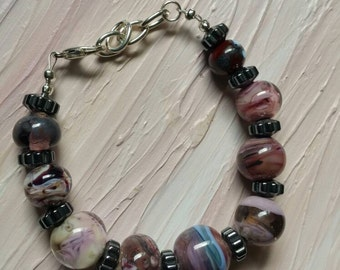 handmade lampwork bracelet in plum fantasy and hematite beads