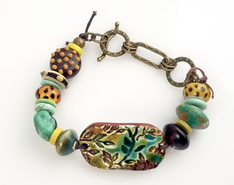 Colorful Ceramic Bracelet with Leaf Focal and Various Ceramic and Glass Beads. VN149