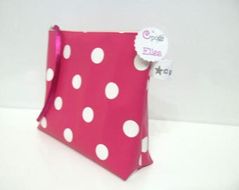 Toiletry bag in pink and white polka dots