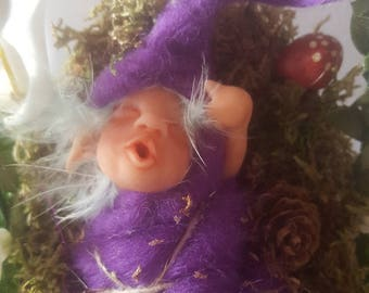 Ooak Elf yawning in his crib of forest, pineapple-bird mushrooms made in Sculpey and felt