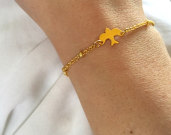 Bracelet with chain with brass beads and bird pendant in 925 silver