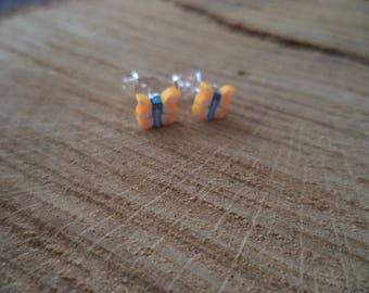 Silver earrings with orange polymer clay butterfly earrings