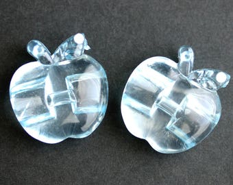 Two (2) Light Blue Apple Buttons. Pale Blue Buttons. Clear Acrylic Buttons. Clear Plastic Buttons with Rhinestone Detail. 24mm x 23mm