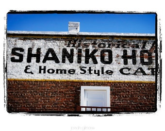 10 x 13 Print Special Shaniko Hotel White Painted Sign on Brown Brick Building with Blue Sky Americana Art print