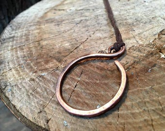 Hand forged copper circle pendant on leather