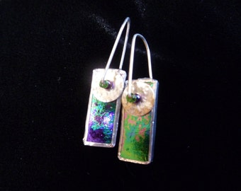 Irridized glass earrings reflecting green and purple