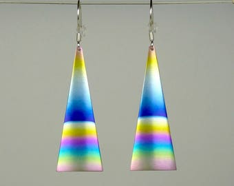 Pair of anodized titanium and silver swinging earrings.
