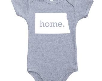Homeland Tees North Dakota Home Unisex Baby Bodysuit