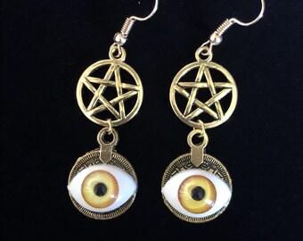 Yellow evil eye pentacle earrings in gold