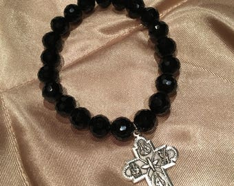Faceted Black stretch bead Bracelet with 4 way cross Charm
