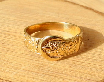 A 9K yellow gold decorated Buckle ring, made in 1978