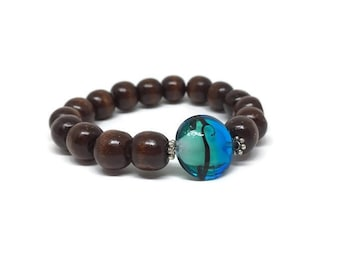 CLEARANCE *** Splendid wood beads bracelet with aqua lampwork 18 mm lentil in the center