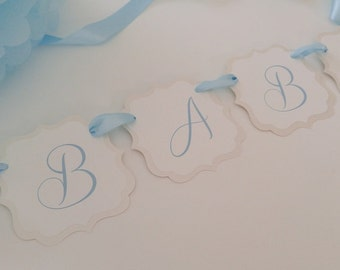 Baby Shower Banner Decoration Prepared in Colors to Coordinate with Your Baby Boy Shower Color Palette