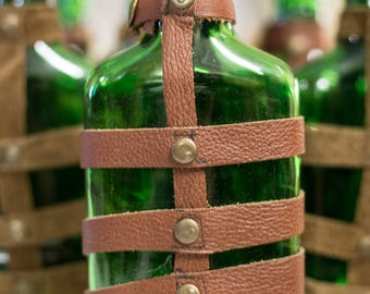 Leather wrapped glass flask.