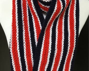 Patriotic hand knitted scarf in red, white and blue with crocheted edges.