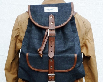 Raw denim & leather backpack