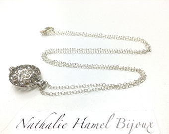 Necklace with a White Pearl in a metal ball that opens all mounted on a plated anti-tarnish chain.