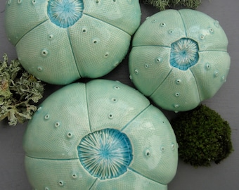 Three Turquoise Green Ceramic Sea Urchins Wall Hanging with Blue Glass