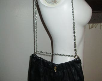 Black vintage 1950's leather purse with gold chain that is adjustable in length