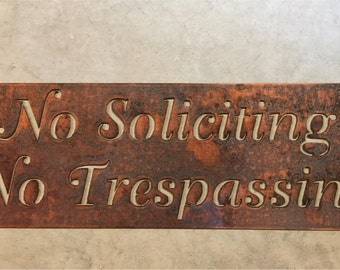 Metal  NO SOLICITING No TRESPASSING sign