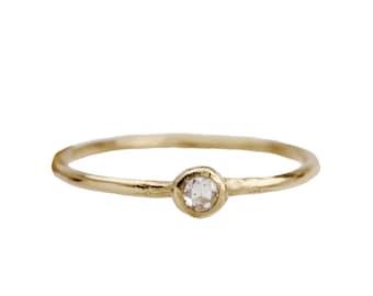 Tiny engagement ring. Rose cut diamond. Friday