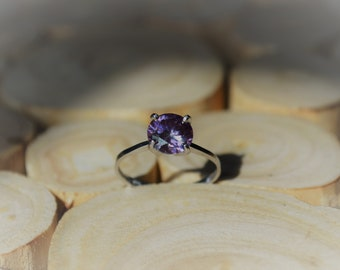 Classic Solid White Gold Ring with Flare, an irredescent Pink Moissanite